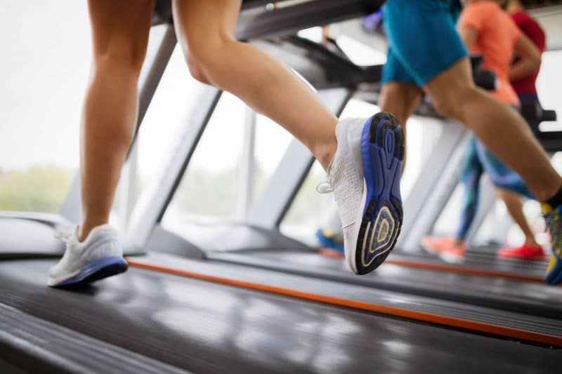 healthy people running on treadmill