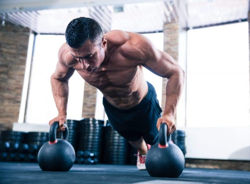 muscular man doing push up