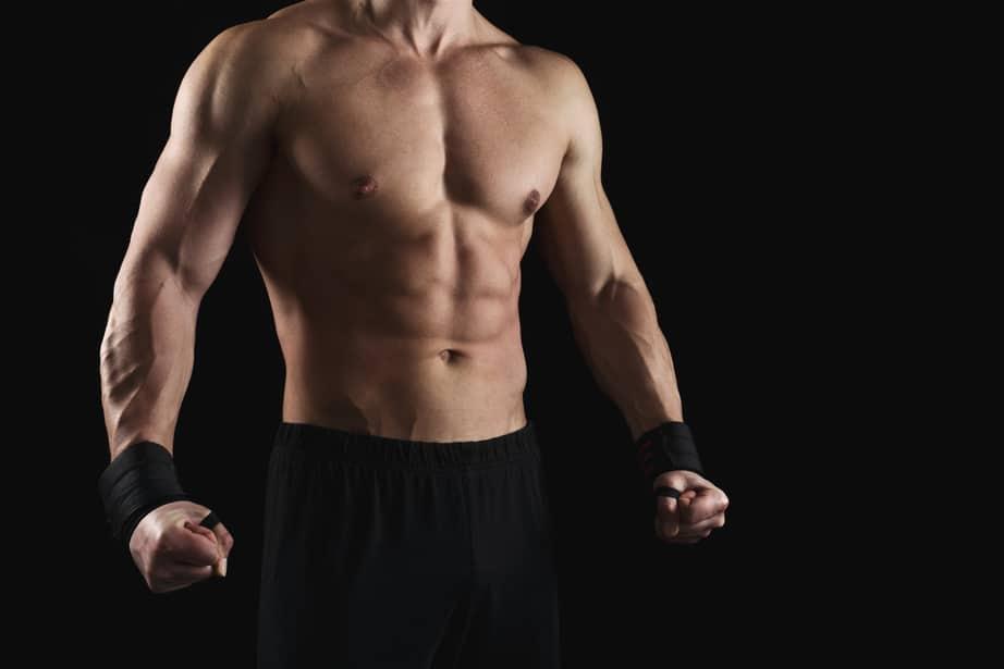 muscular man showing abs